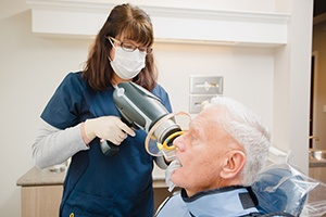 Dental assistnat capturing digital x-rays