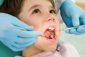 Child getting a dental exam