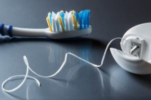 Toothbrush and floss on table by dentist near Michigan City